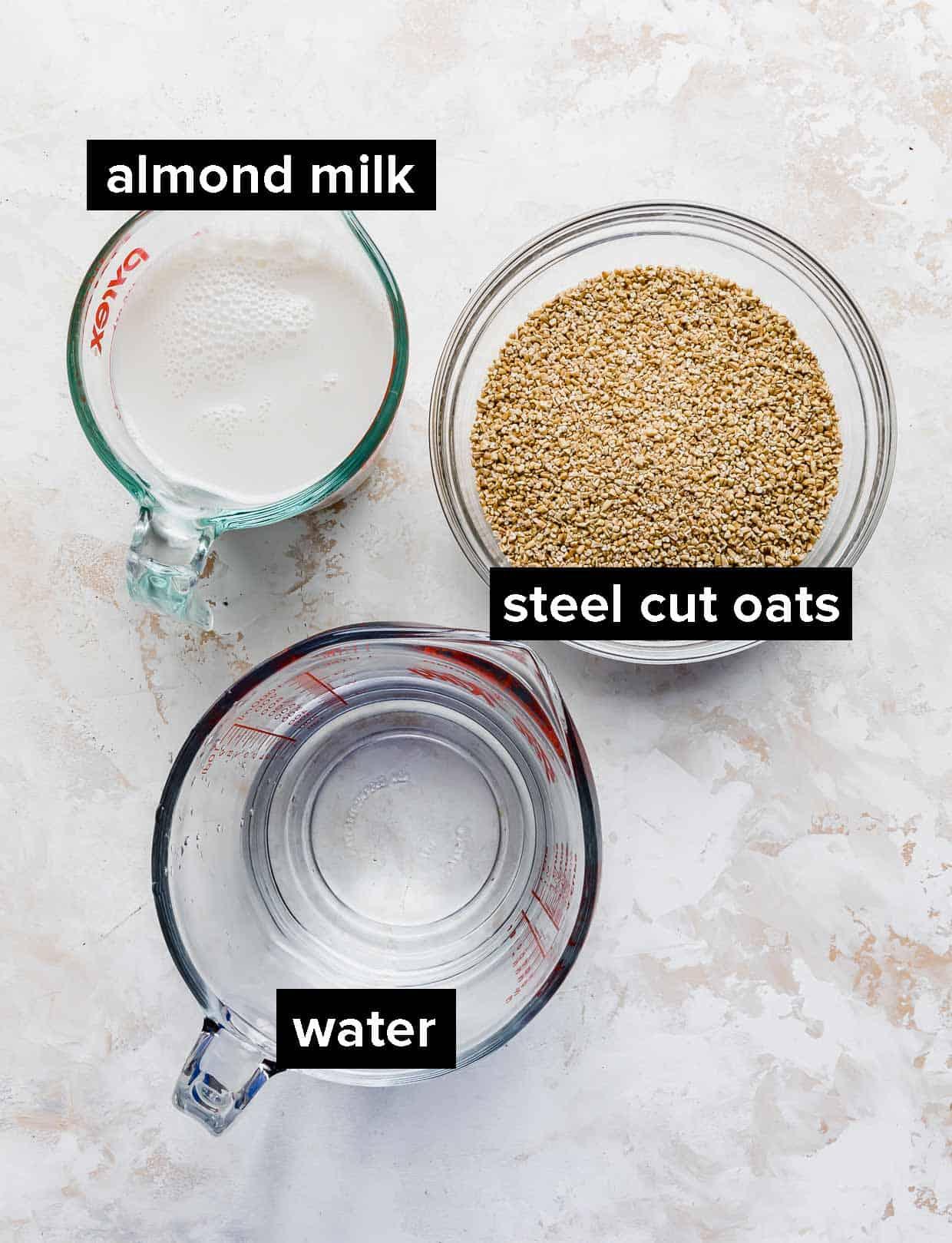 Ingredients used to make steel cut oats; water, almond milk, and steel cut oats.
