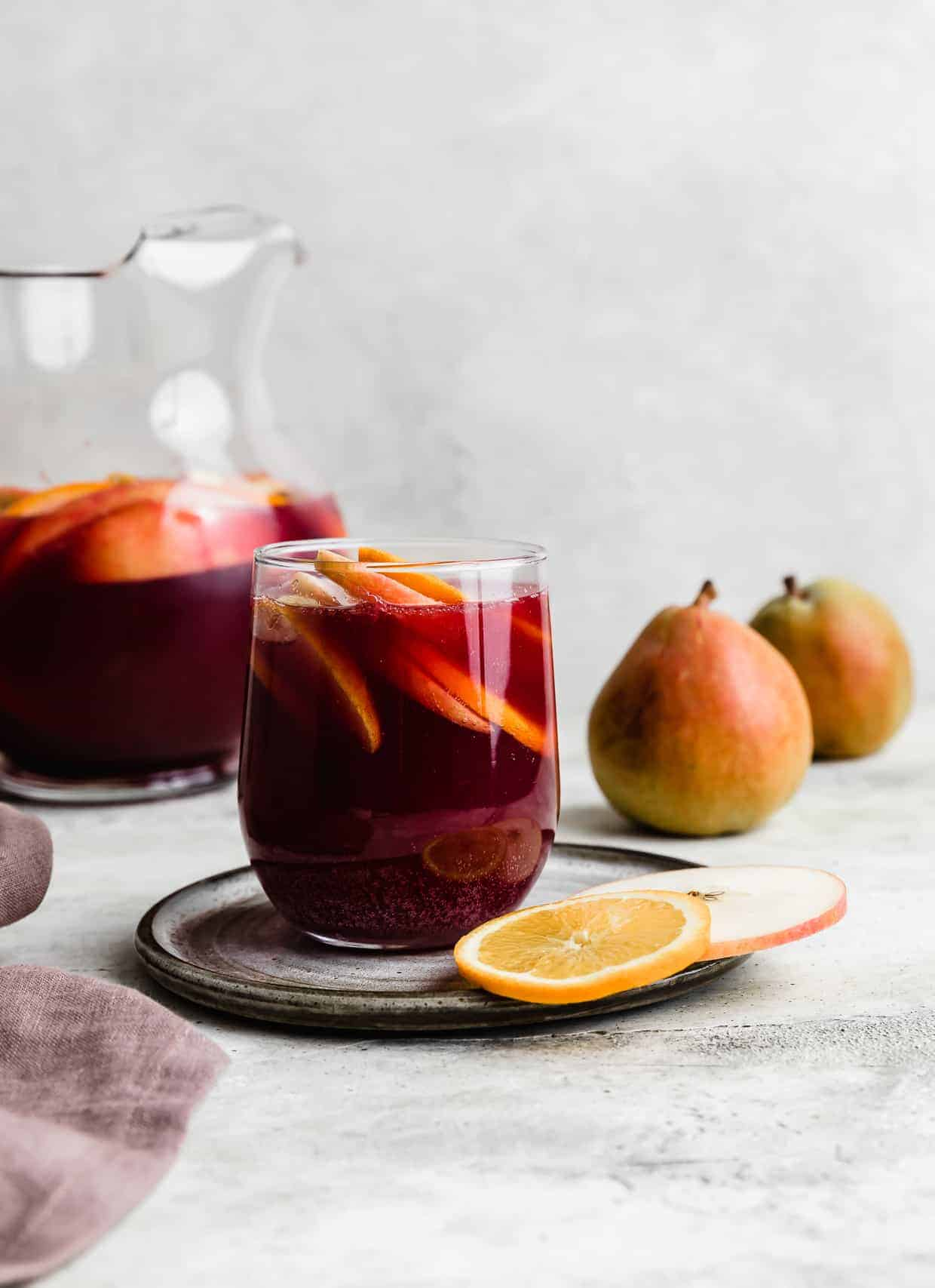 A glass of Non-Alcoholic Sangria against a gray background.
