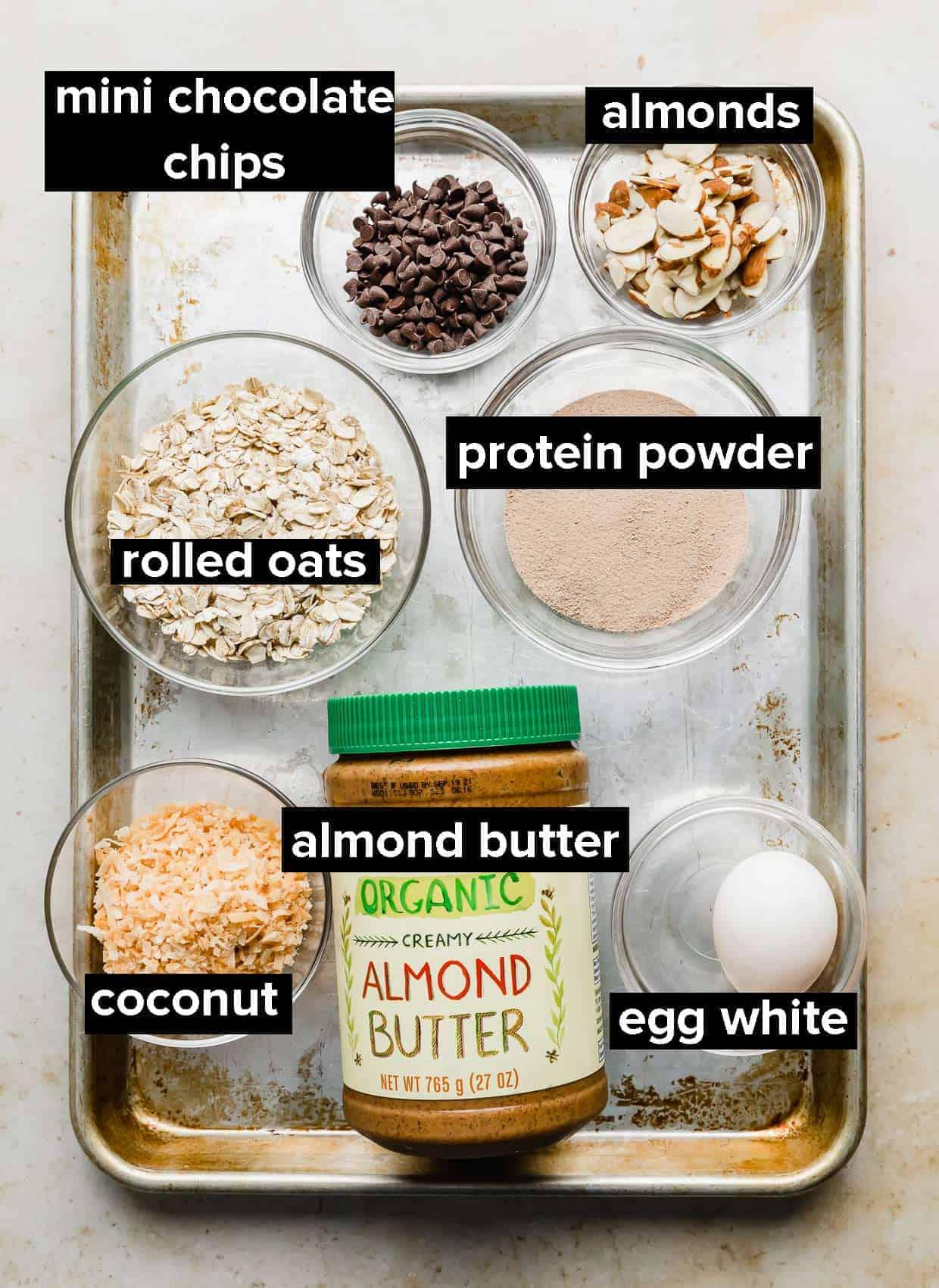 Ingredients used to make Almond Joy Oatmeal on a baking sheet.