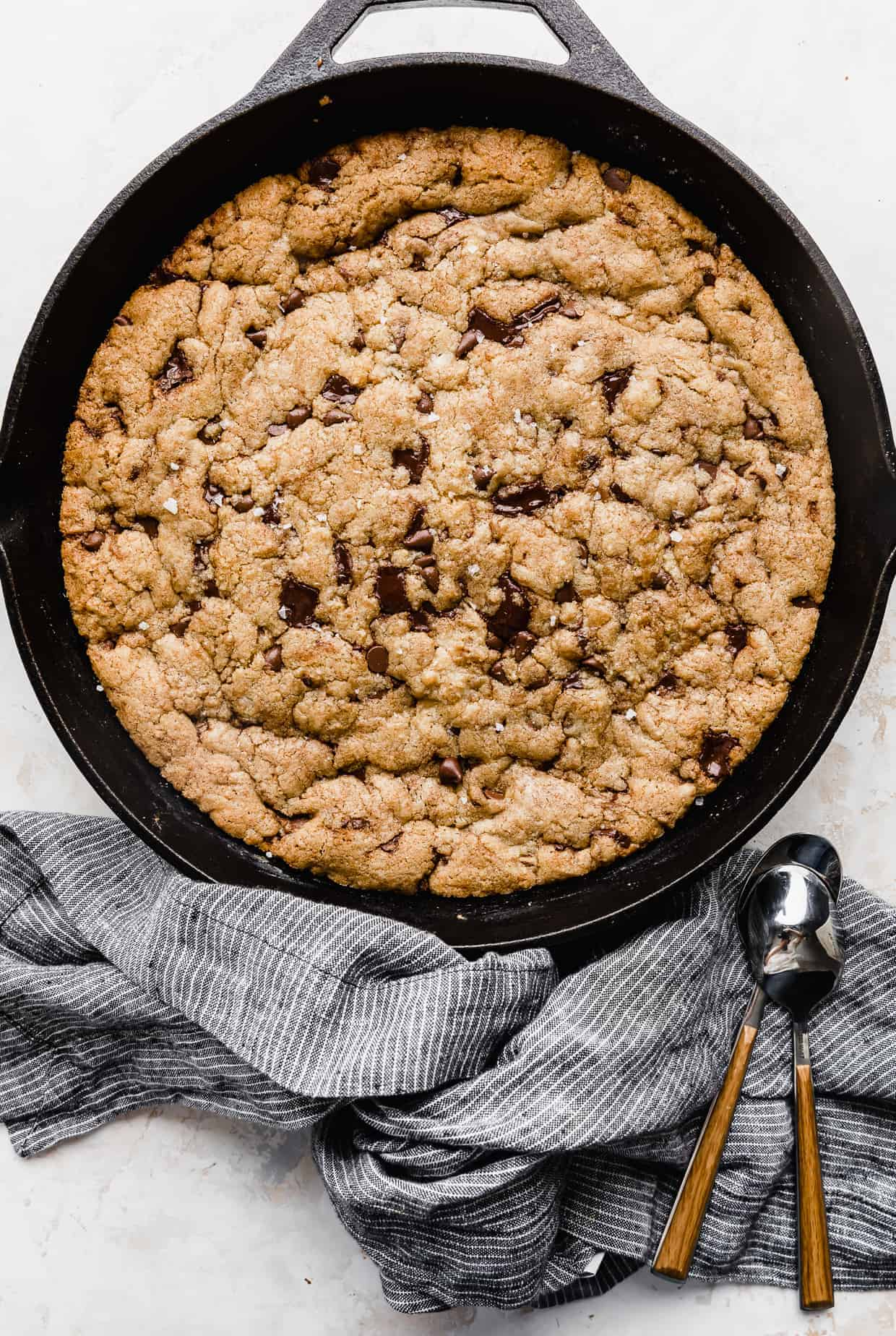 A pizookie in a skillet on a white background.