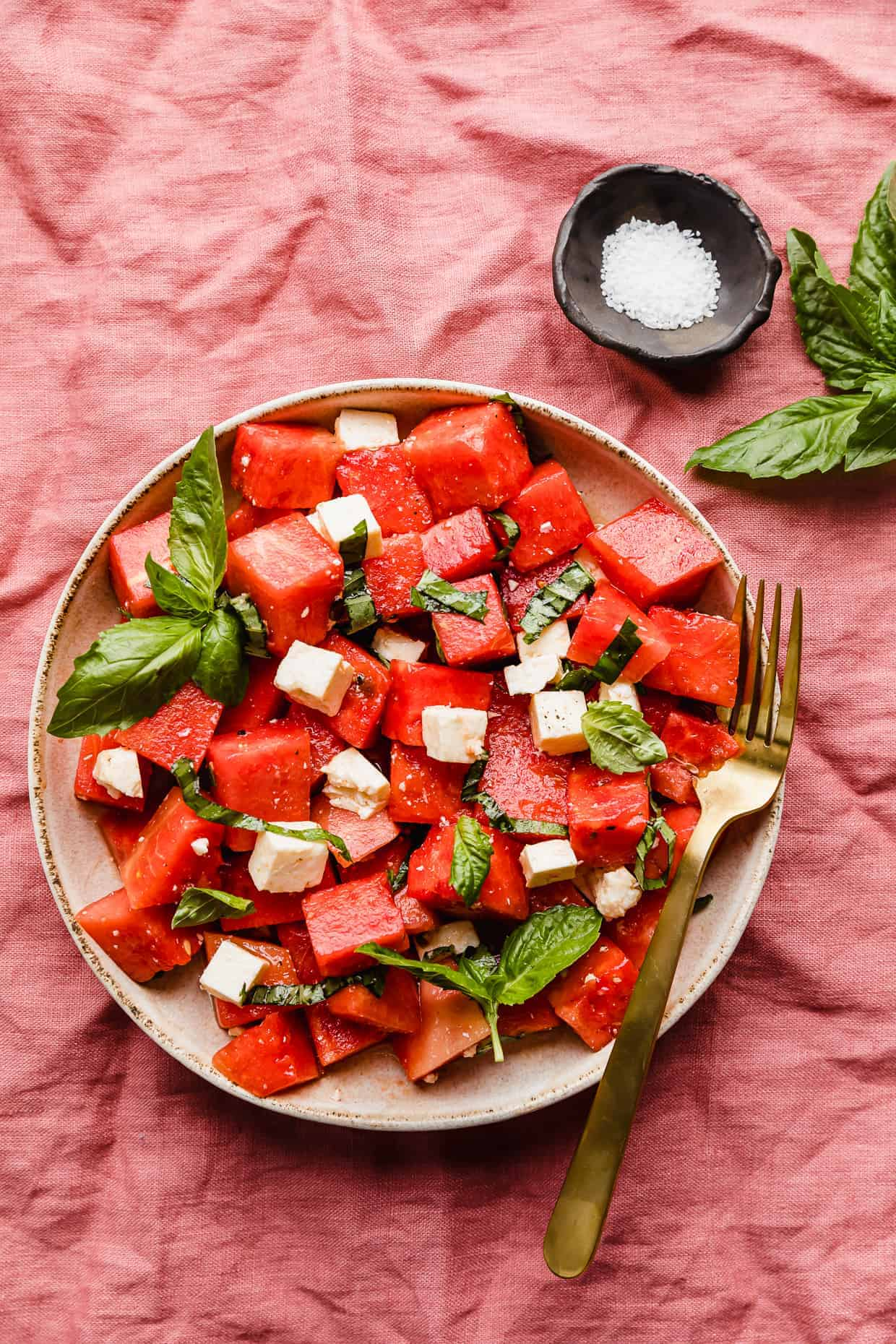 A Watermelon Feta Basil Salad on large plate.