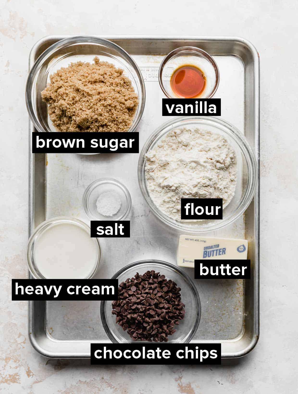 ingredients used to make edible cookie dough bites on a baking sheet.