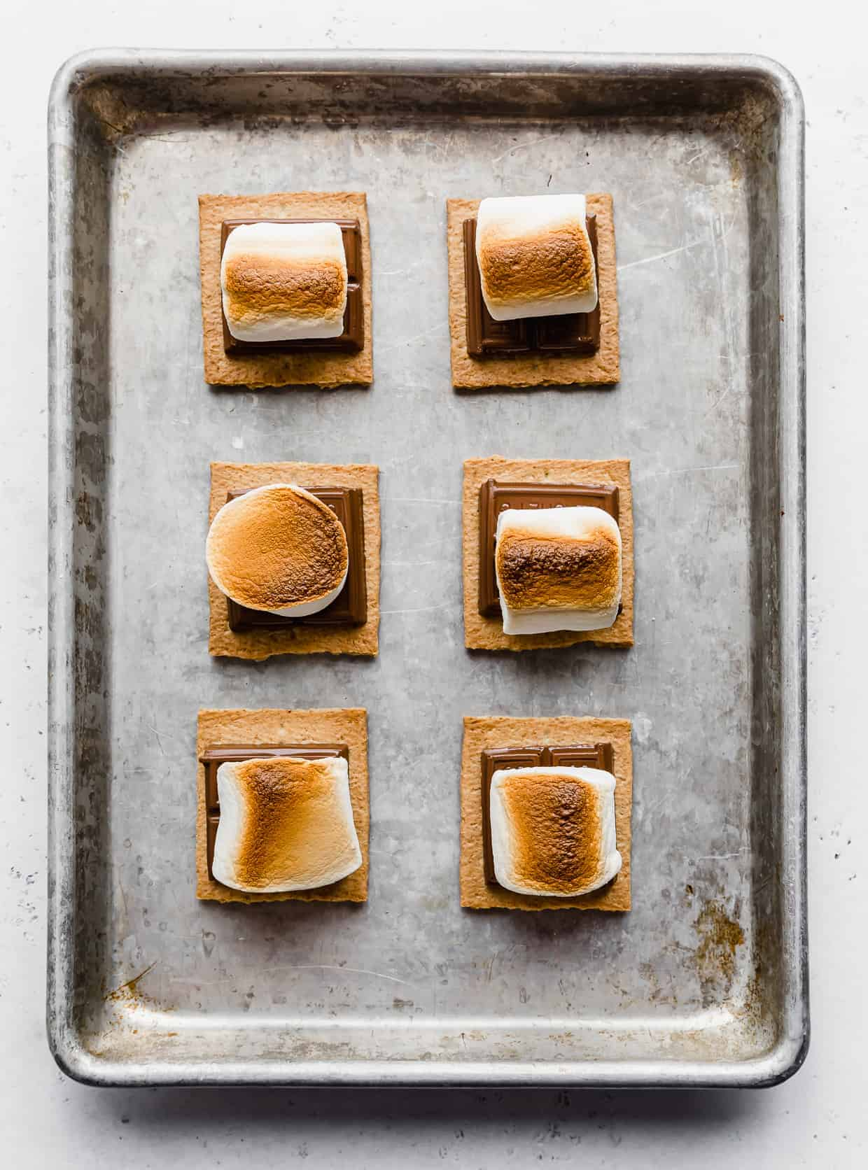 Toasted Oven S'mores on a baking sheet.