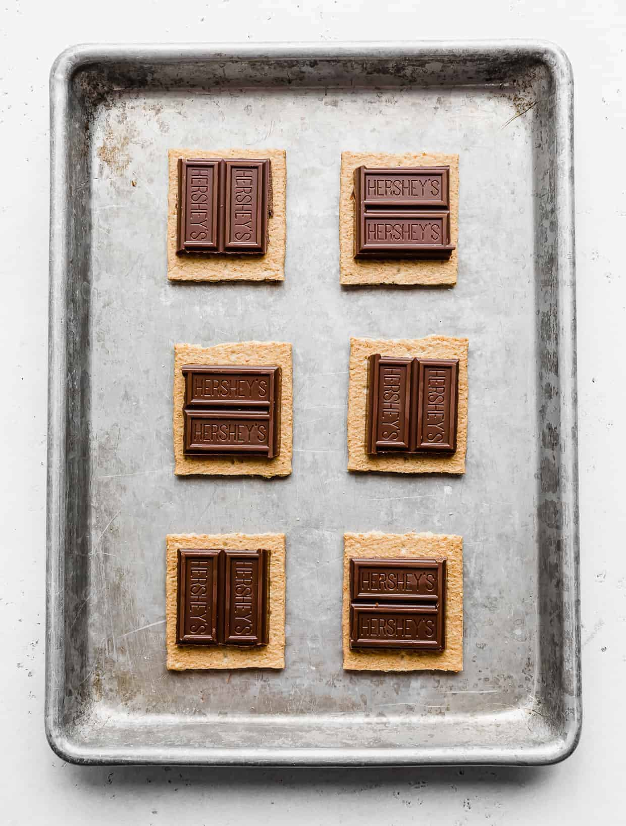 Chocolate Hershey's squares on top of graham cracker squares.