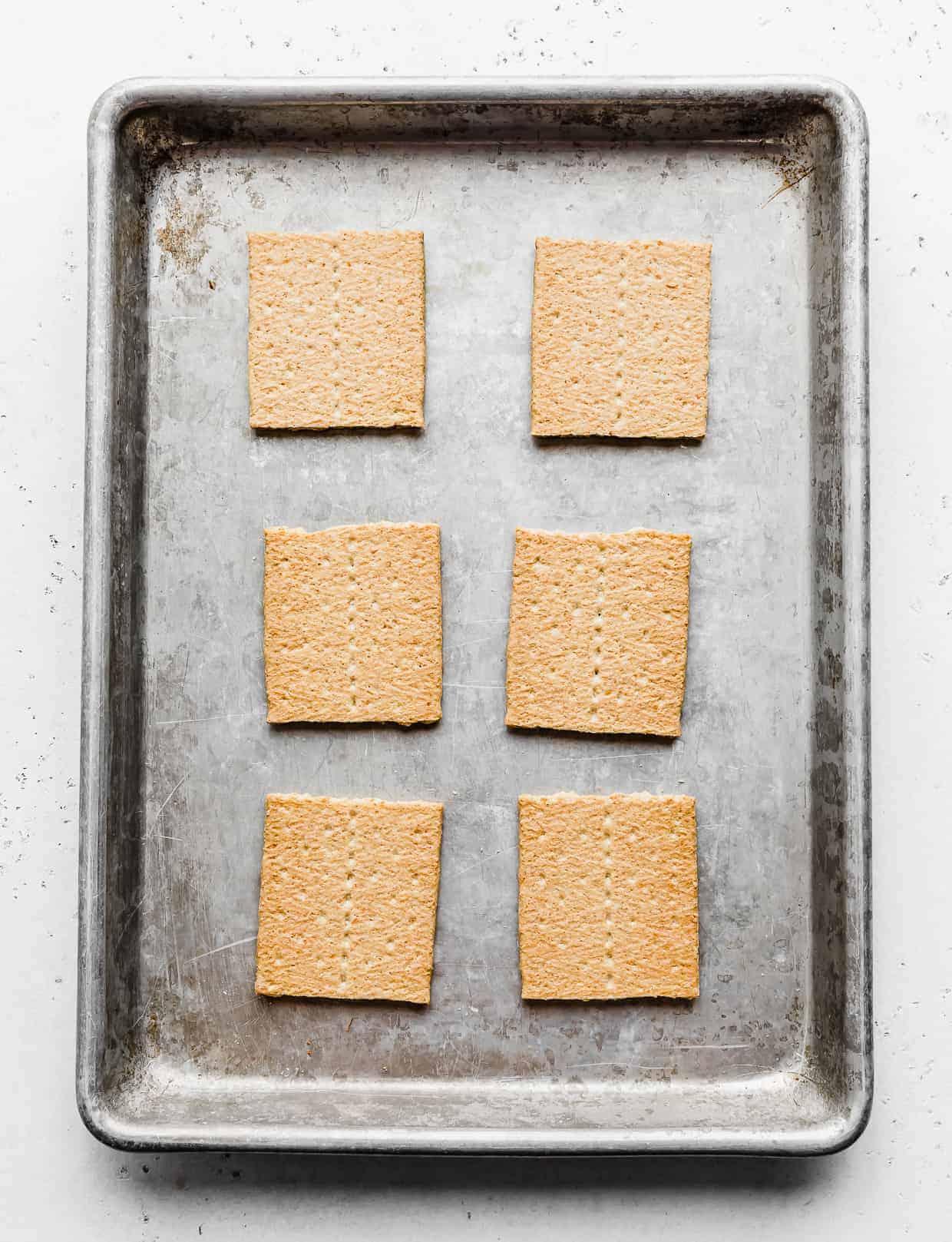 6 graham cracker squares on a baking sheet.