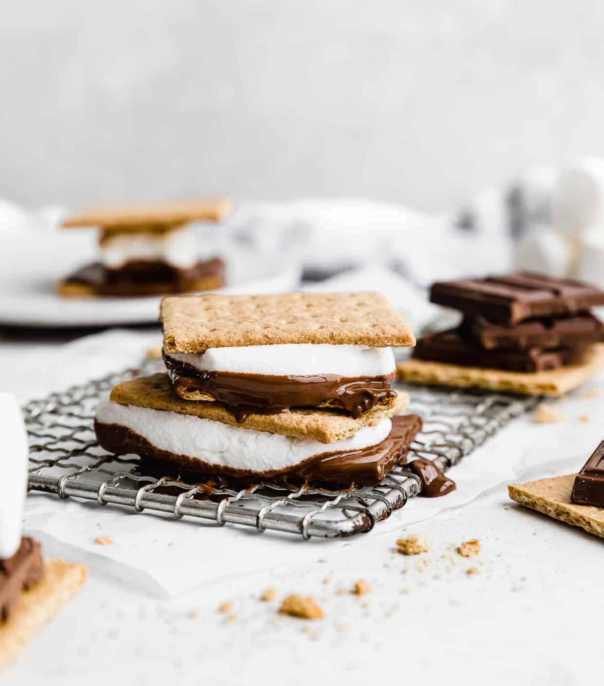 Oven s'mores on a wire cooling rack against a white background.