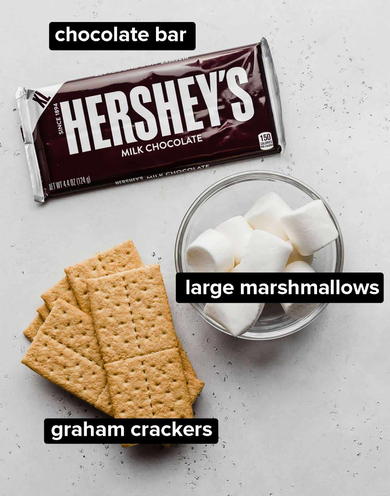 Ingredients used to make oven s'mores: graham cracker, marshmallow, chocolate.