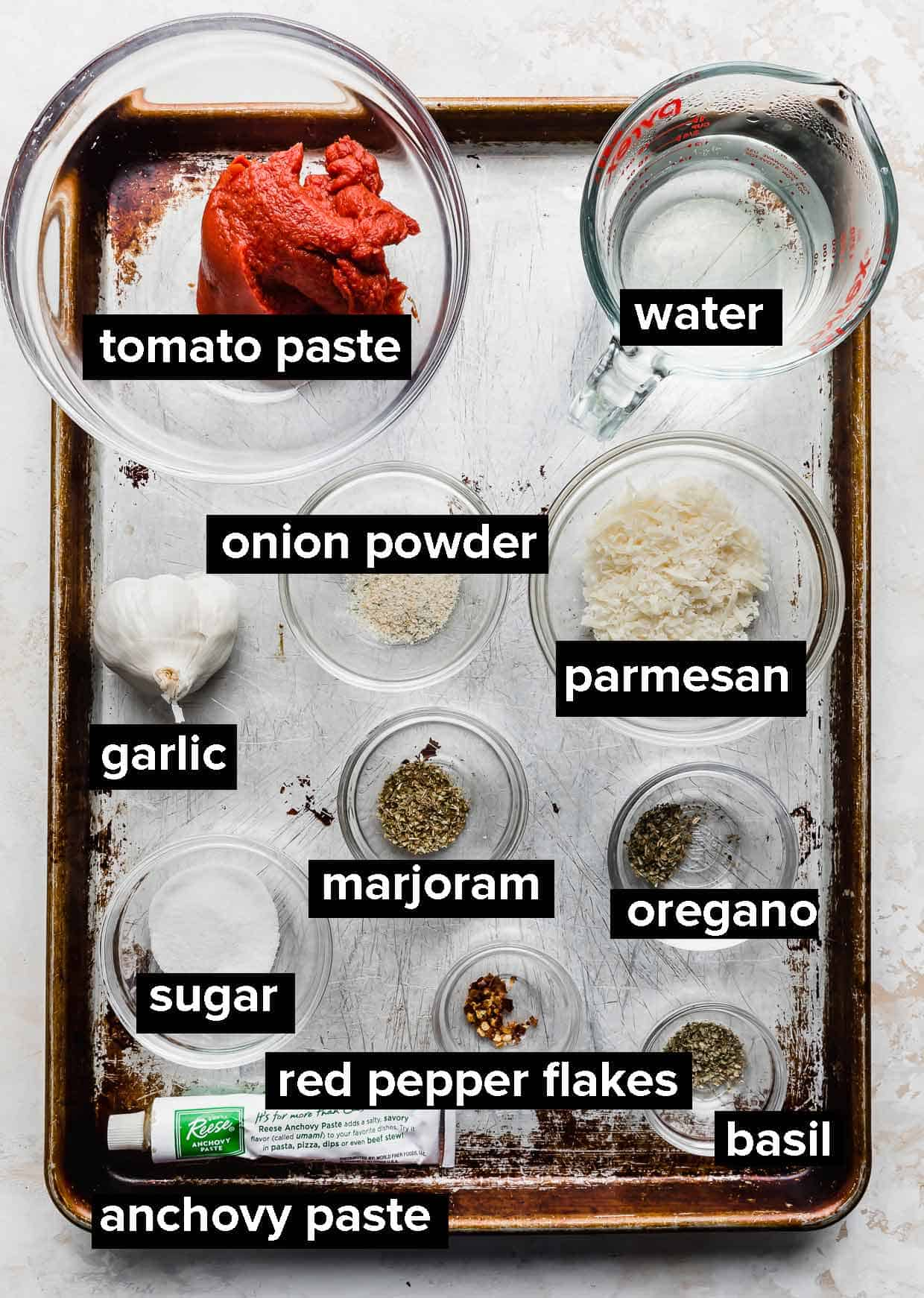 Ingredients used to make pizza sauce from tomato paste.