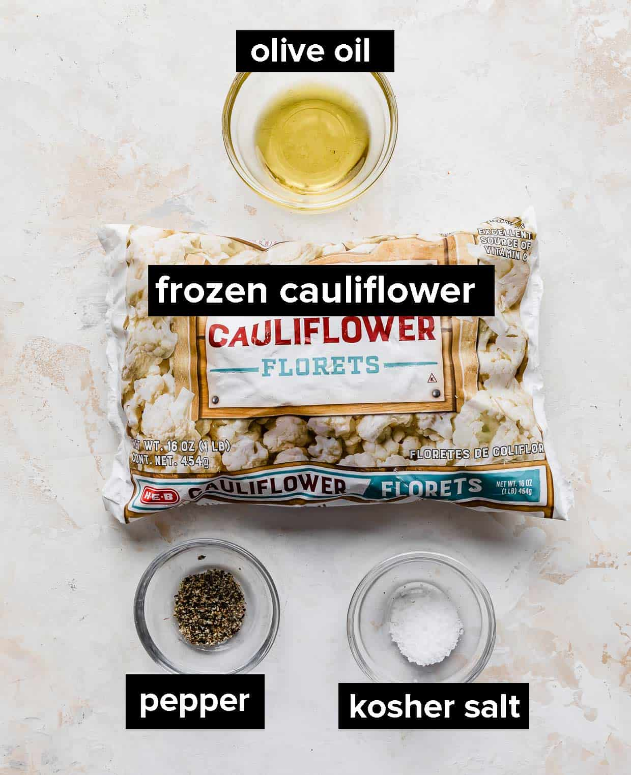Ingredients used to make Roasted Frozen Cauliflower against a textured white background.