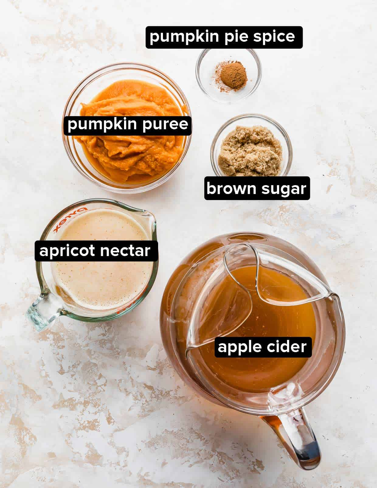 Ingredients used to make Harry Potter pumpkin juice on a textured background.