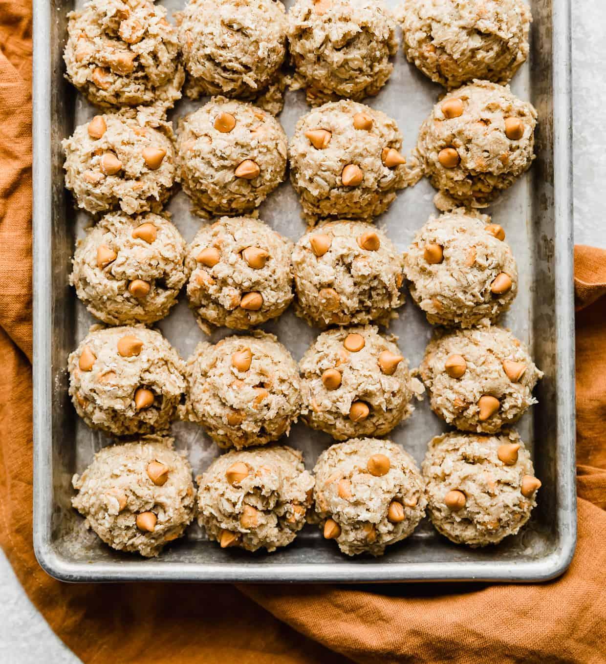 Oatmeal Butterscotch Cookie dough balls on a baking sheet.