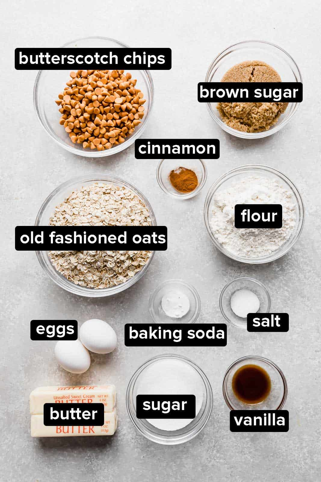 Ingredients used to make oatmeal scotchies on a gray background.