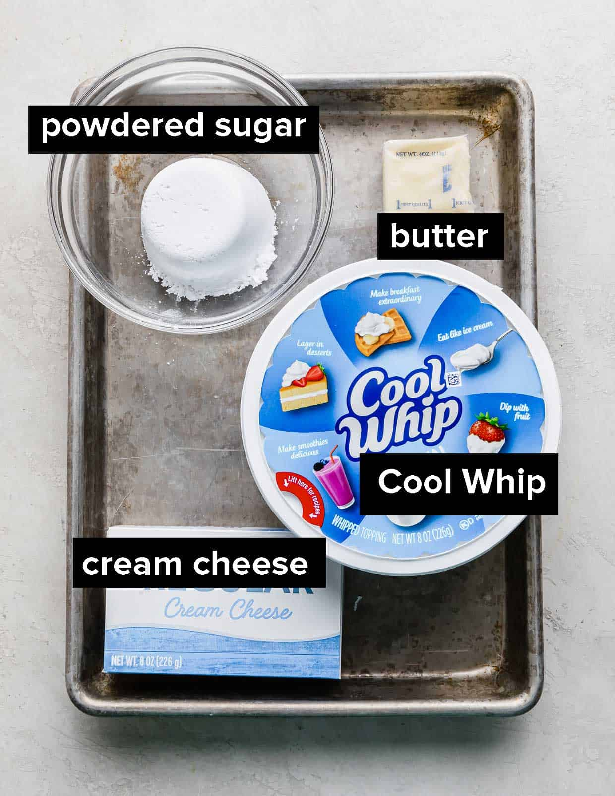 Ingredients used to make a cream cheese whipped cream layer on a baking sheet.