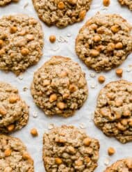 Oatmeal Butterscotch Cookies on a white parchment paper.