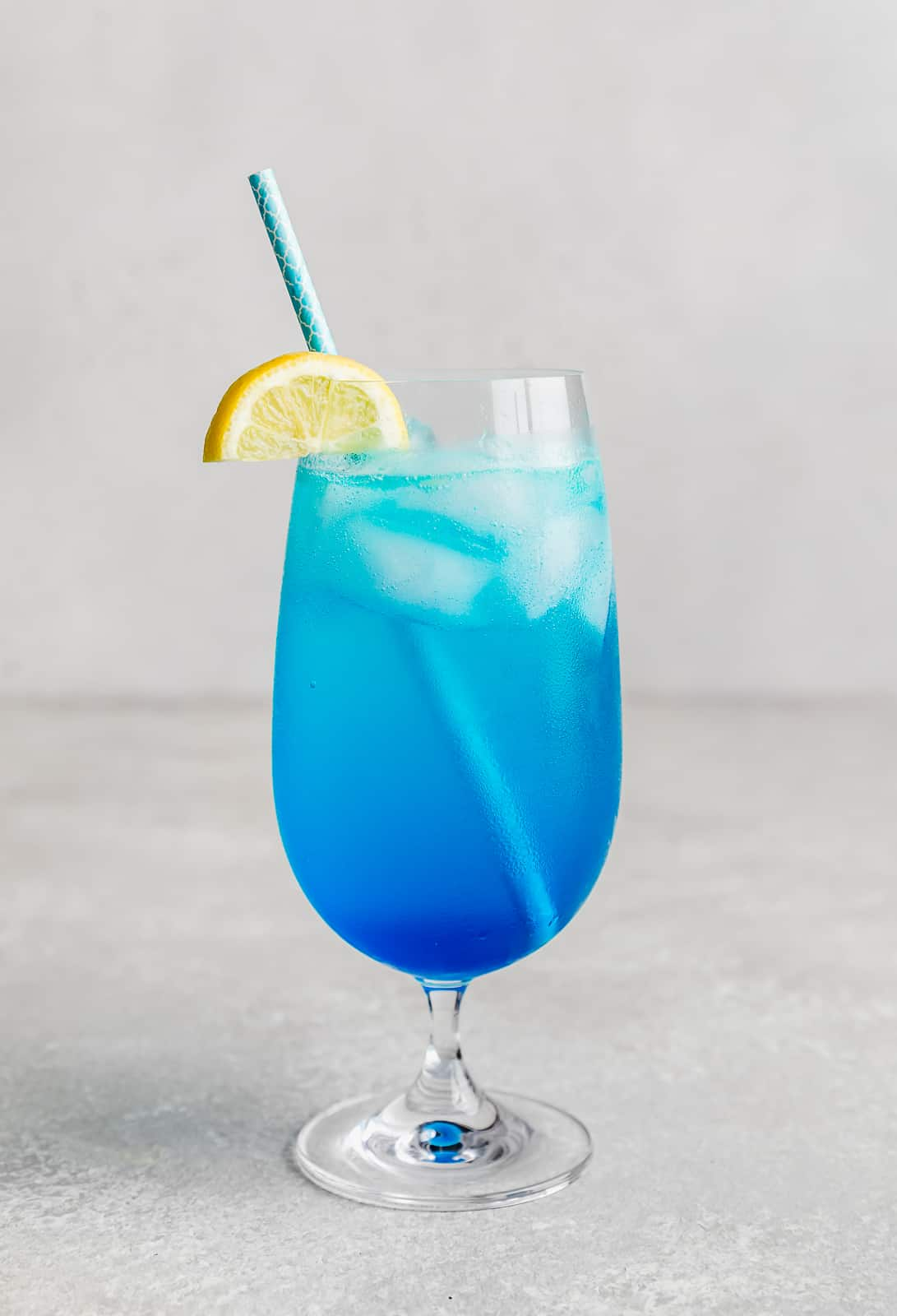 A Blue Lagoon Mocktail against a white background.