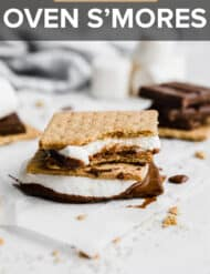 A s'mores against a white background with a bite taken out of it.