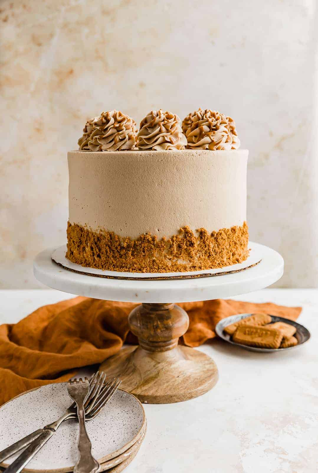 An eight inch Biscoff cake covered in Biscoff buttercream and Biscoff crumbs.