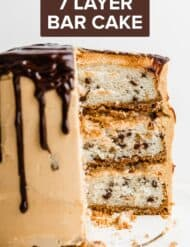 A 3 layered 7 Layer Bar Cake with a chocolate drip down the sides.