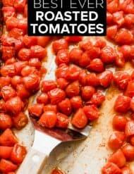 Shriveled red tomatoes on a baking sheet.