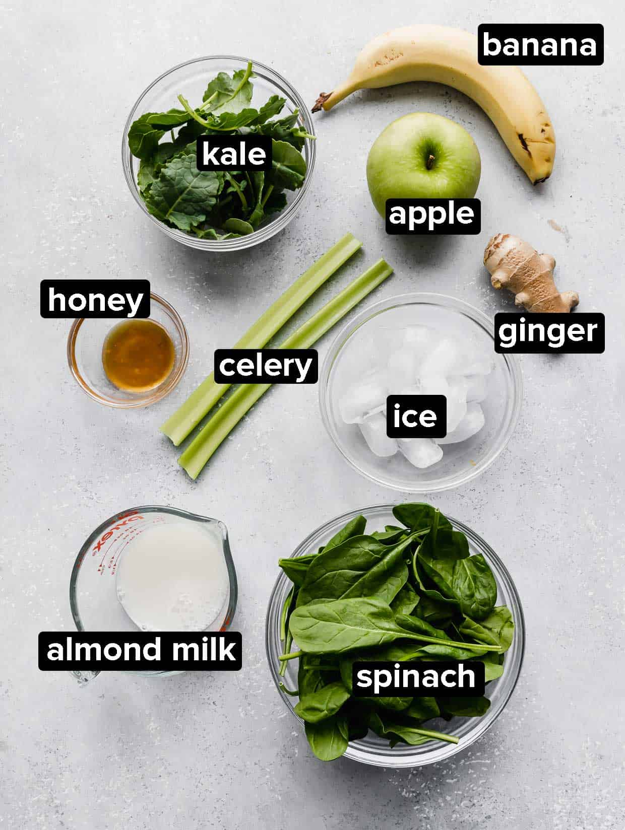 Ingredients used to make a celery smoothie: celery, apple, kale, spinach, banana, milk.