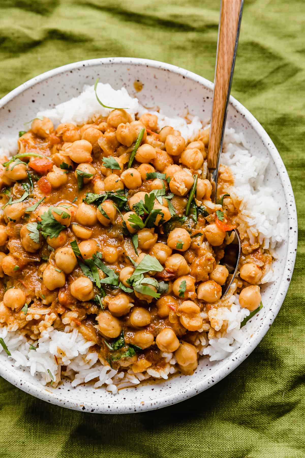 Chickpea and Spinach Curry on a bed or white rice.