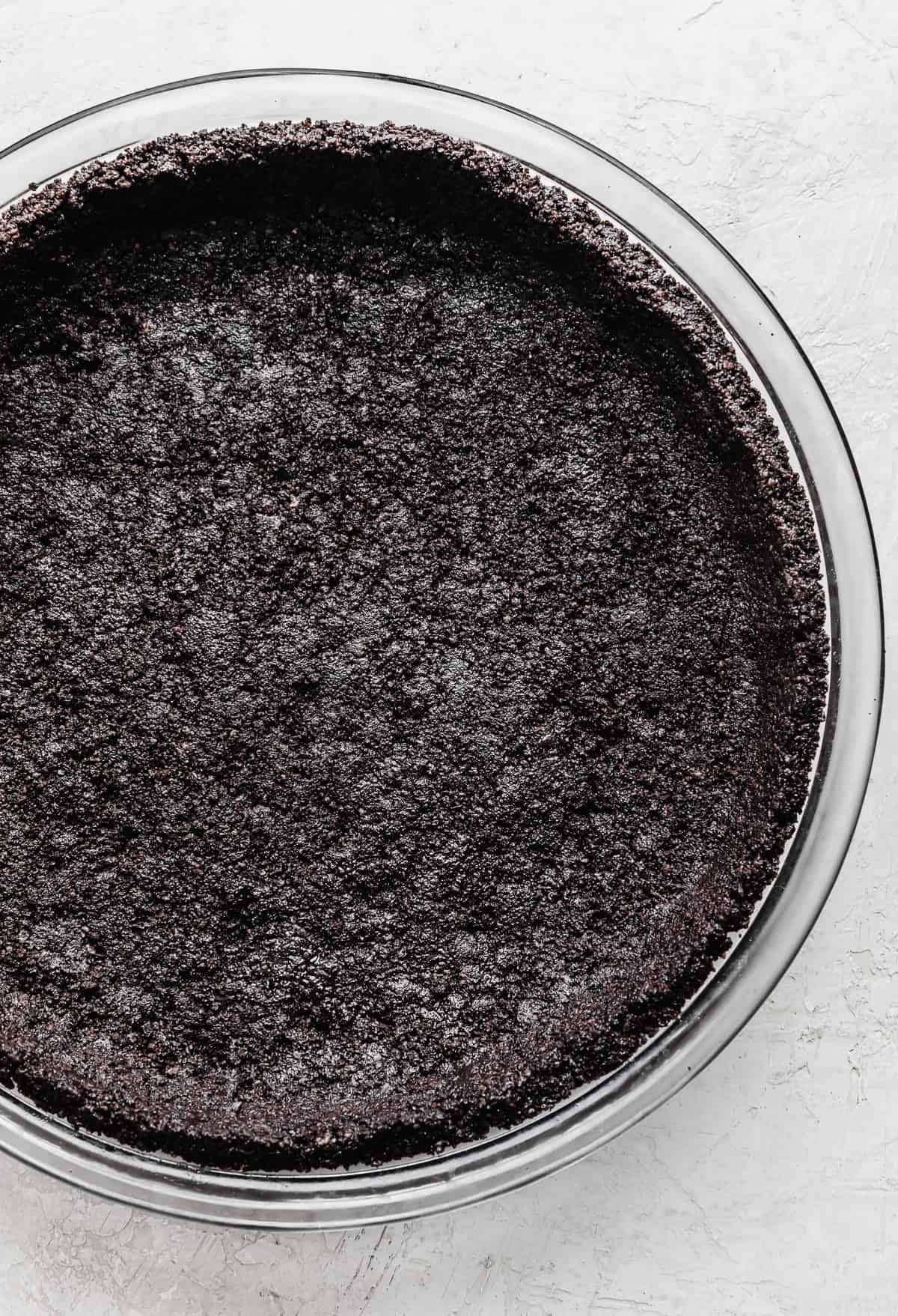 An Oreo Pie Crust on a gray textured background.