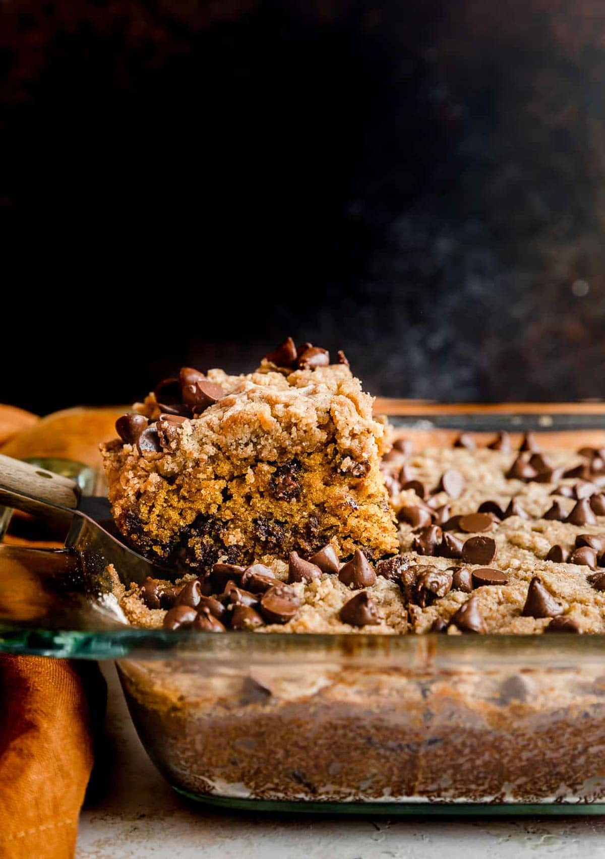 Pumpkin Chocolate Chip Coffee Cake against a brown background.
