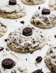 A Crumbl Cookies and Cream Milkshake Cookie on a white parchment paper.