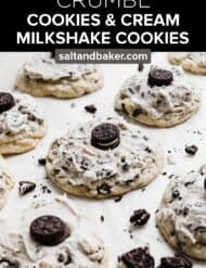 A Crumbl Cookies and Cream Milkshake Cookie on a white parchment paper with a mini Oreo on the cookie.
