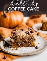 Pumpkin Chocolate Chip Coffee Cake on a white plate with pumpkins in the background.