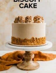 A Biscoff Cake on a cake stand.