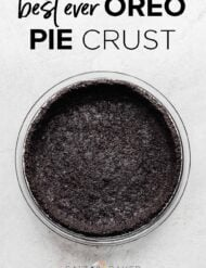 An Oreo pie crust on a gray background.